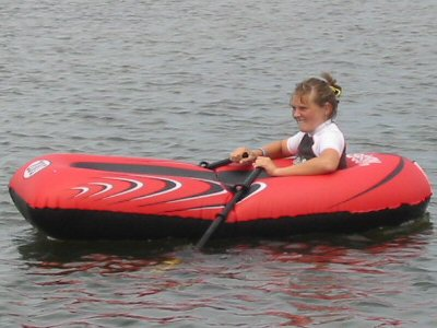 Plastic Inflatable Toy Boat on Lake Tyers