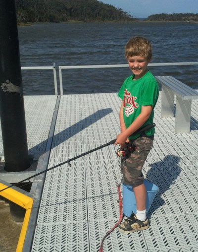 Lad on new jetty at Fishermans Landing, Lake Tyers