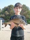 Tommy with a 37cm Bream at Lake Tyers Beach